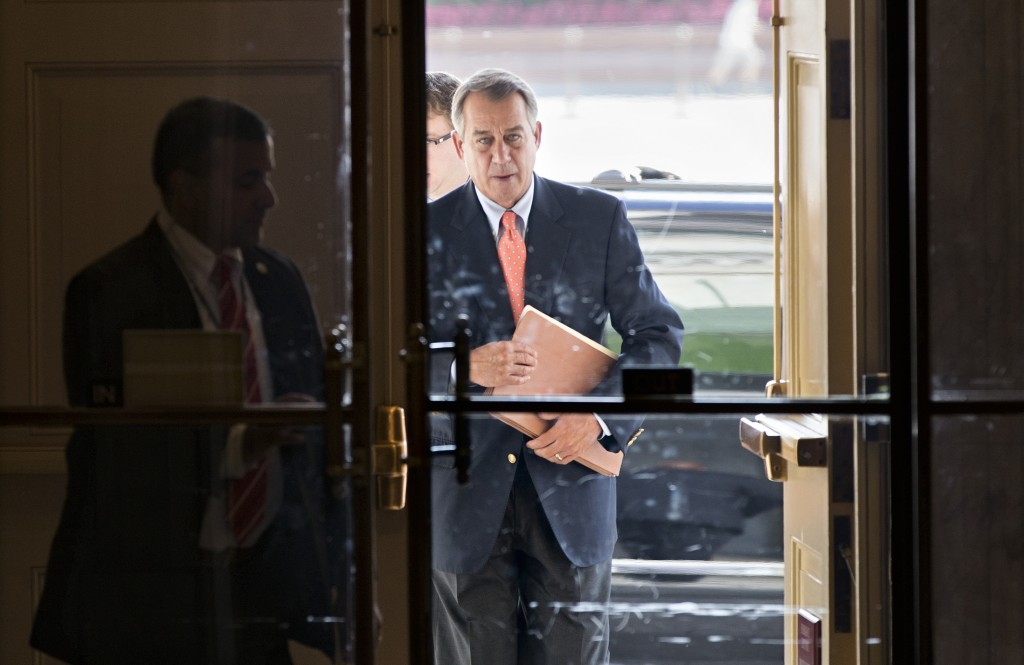 Speaker of the House John Boehner, R-Ohio, arrives at the Capitol in Washington on Saturday. The Republican-controlled House and the Democrat-controlled Senate are at an impasse, neither side backing down after House GOP conservatives linked the funding bill to obstructing President Obama's signature health care law. There has been no sign of progress toward ending the government shutdown that has idled 800,000 federal workers and curbed services around the country.