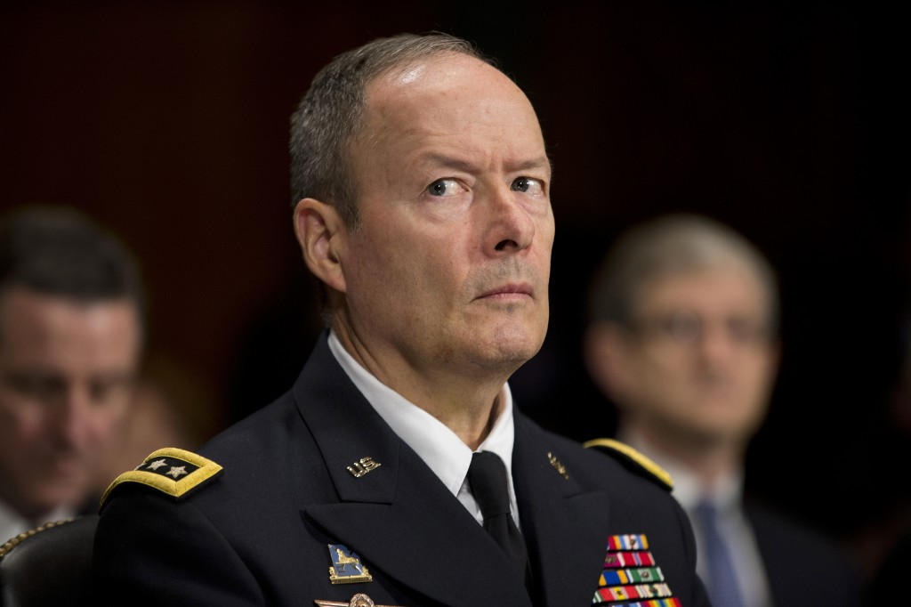National Security Agency Director Gen. Keith Alexander pauses while testifying on Capitol Hill Wednesday before the Senate Judiciary Committee oversight hearing on the Foreign Intelligence Surveillance Act. U.S. intelligence officials say the government shutdown is seriously damaging the intelligence community's ability to guard against threats.