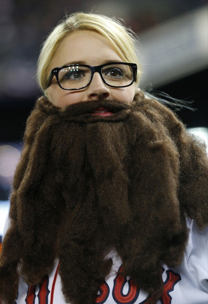 Boston Red Sox fan Shaylan Spurway sports a fake beard before Game 5 of the American League baseball championship series against the Detroit Tigers, Thursday, Oct. 17, 2013, in Detroit.
