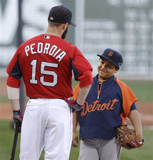 Victor Jose Martinez, son of Tigers' designated hitter Victor Martinez, talks with Red Sox second baseman Dustin Pedroia on Friday at Fenway Park in Boston. Fenway Park
