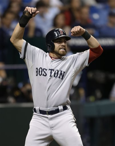 HUGE RUN: Boston's Jacoby Ellsbury celebrates after scoring the go-ahead run on Shane Victorino's infield single inthe seventh inning of the Red Sox' 3-1 win over Tampa Bay in Game 4 of the American League Division Series on Tuesday in St. Petersburgh, Fla. AP photo Tropicana Field