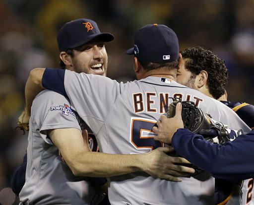 Detroit Tigers pitcher Joaquin Benoit (53) is congratulated by starting pitcher Justin Verlander, left, after the Tigers beat the Oakland Athletics 3-0 to win Game 5 of an American League baseball division series in Oakland, Calif., Thursday, Oct. 10, 2013. (AP Photo/Marcio Jose Sanchez) O.co Coliseum