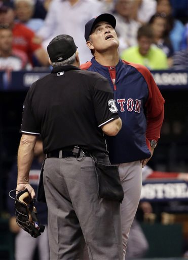 Boston Red Sox manager John Farrell, right, questions home plate umpire Paul Emmel after a fourth inning foul ball by Tampa Bay Rays' Ben Zobrist hits the catwalk in Game 3 of an American League baseball division series, Monday, Oct. 7, 2013, in St. Petersburg, Fla. (AP Photo/Chris O'Meara) Tropicana Field