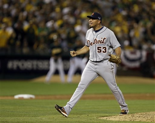 Detroit Tigers pitcher Joaquin Benoit shouts after striking out the last batter in the ninth inning for a 3-2 win over the Oakland Athletics in Game 1 of the American League baseball division series in Oakland, Calif., Friday, Oct. 4, 2013. (AP Photo/Ben Margot) O.co Coliseum