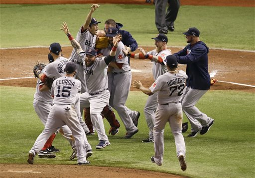 Boston Red Sox players celebrate after defeating the Tampa Bay Rays 3-1 to win baseball's American League division series, Tuesday, Oct. 8, 2013, in St. Petersburg, Fla. (AP Photo/John Raoux) Tropicana Field;Tampa Bay Rays