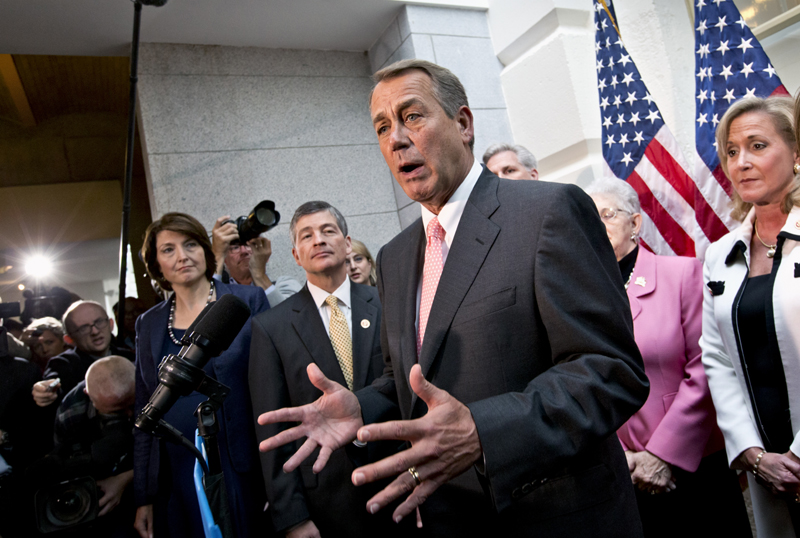 House Speaker John Boehner, joined by fellow Republicans, speaks during a news conference on Capitol Hill in Washington on Thursday, following a closed-door GOP meeting, to announce that House Republicans will advance legislation to temporarily extend the government's ability to borrow money to meet its financial obligations. From left are Rep. Cathy McMorris Rodgers, R-Wash., Rep. Jeb Hensarling, R-Texas, Boehner, Majority Whip Kevin McCarthy of Calif., Rep. Virginia Foxx, R-N.C., and Rep. Ann Wagner, R-Mo.