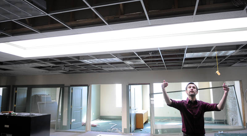 William Guerrette III is overseeing a project to renovate his family's building at 227 Water St. in Augusta to build nine apartment units. He gave a tour of the third floor Thursday, where most apartments will be located and features a skylight.