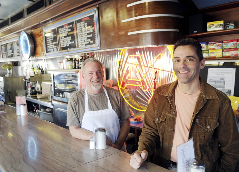 A1 Diner owners Mike Giberson, left, and Neil Anderson are celebrating the 25th anniversary of the Gardiner landmark. The men took a break from preparing food Wednesday to discuss their restaurant.