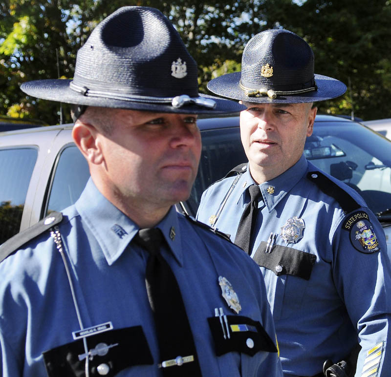 State Police Maj. Gary Wright, right, inspects Sgt. Nicholas Grass Tuesday during an inspection by the agency's command staff at the capitol in Augusta. Troopers from across the region assembled outside the State House to be reviewed individually by the agency's majors and colonels during the ceremony.