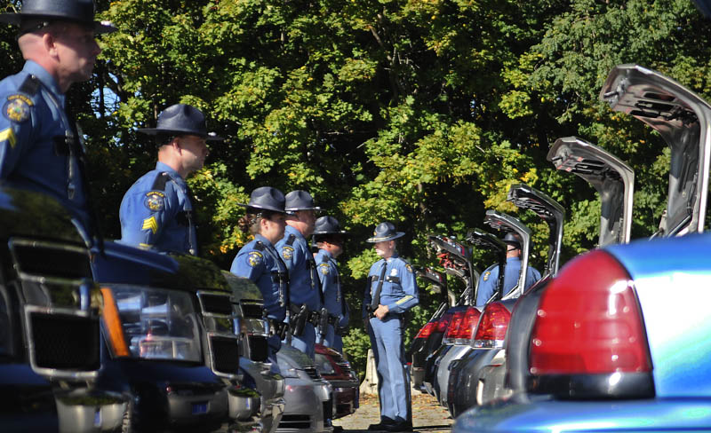 State Police Col. Robert Williams, center, inspects officers and their vehicles Tuesday at the capitol in Augusta. Each trooper and vehicle was reviewed individually by the agency's majors and colonels during the ceremony.