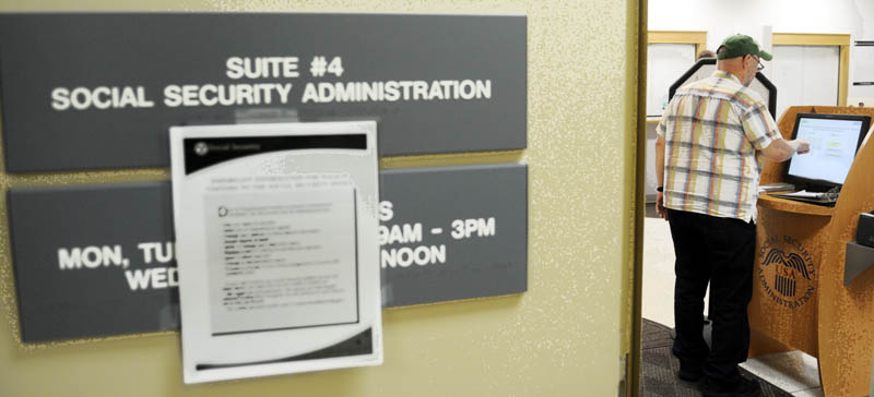 """Don Register fills out a form today at the Social Security Administration's offices in Augusta. The federal agency has reduced services because of the shutdown by is still providing assistance to some. """"I think it's crazy,"""" the Augusta resident said of the closure of federal government offices."""