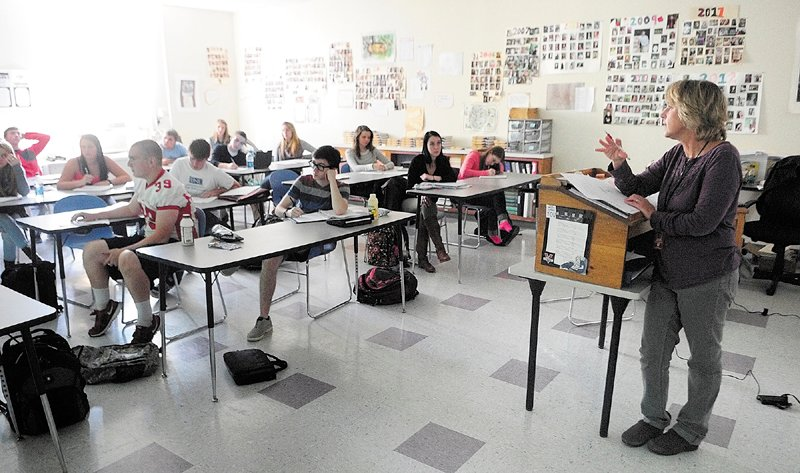 Laurie Rodrigue talks to her college prep English 4 class before students start doing presentations on Friday at Capital Area Tech Center in Augusta.