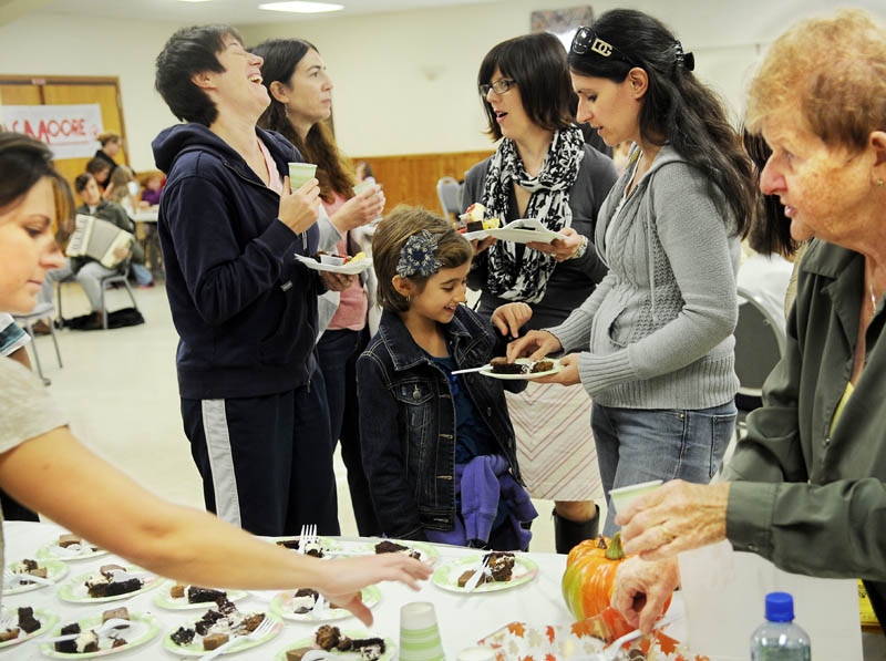 Guests at the Bread of Life Chocolate Festival Sunday in Augusta consume sweets at the Kennebec Chocolates table. Money from donated chocolate and silent auction items will offset costs at Bread of Life, which operates a food kitchen, homeless shelter and veterans shelter in Augusta.