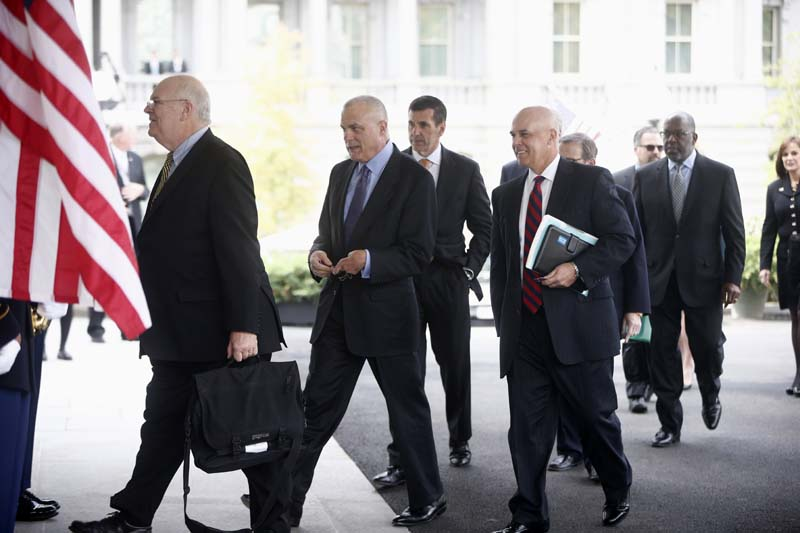 From left, Tufts Health Plan President and CEO James Roosevelt, Aetna CEO Mark Bertolini, Humana CEO Bruce Broussard, Blue Cross Blue Shield of Florida CEO Patrick Geraghty, Kaiser Permanente CEO Bernard Tyson, and other health care chief executive officers arrive at the White House in Washington on Wednesday to meet with White House officials regarding President Barack Obama's health care law.