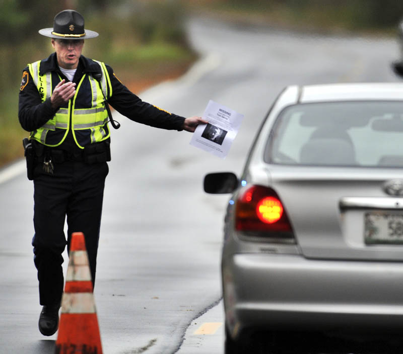 STILL MISSING: Winthrop Police Dept. Captain Ryan Frost pulls over a motorist Sunday October 13, 2013 on the Stanley Road in Winthrop while conducting a road block to ask motorists about Thomas Devoy, who has been missing from his Winthrop home since last Sunday. Police still have no clues about the 60-year-old's whereabouts and were hoping to receive information that provide a lead during the roadblock, according to Frost. Police provided drivers a flyer with a photo and description of Devoy with a request for anyone with information to call the Winthrop Police.