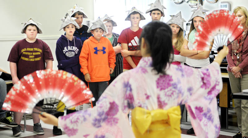 Richmond Middle School students watch exchange student Satoko Suwanai, 16, perform a traditional Japanese dance Tuesday at the school in Richmond. The school hosted 10 teenagers and four chaperones participating in the annual exchange with Hall-Dale High School. Richmond students learned about Japanese origami, music and tea ceremonies in addition to dance. Richmond schools began teaching Japanese last year, according to principal Steve Lavoie.
