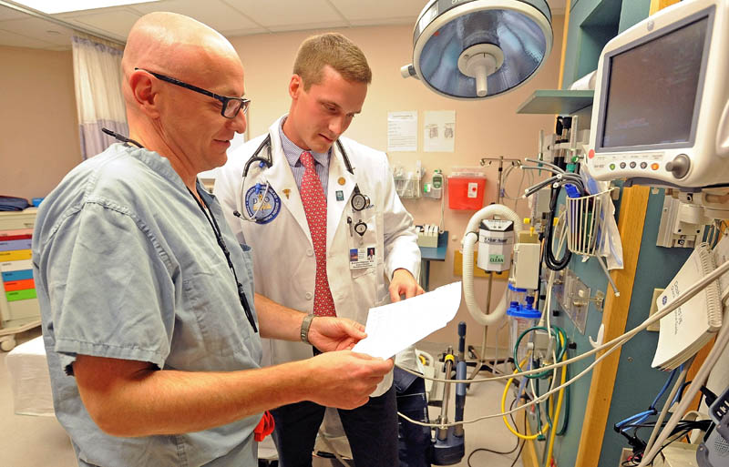 Brandon Giberson, 26, right, works with Dr. John Comis, director of the emergency department at Redington-Fairview General Hospital in Skowhegan, on Wednesday. Comis has acted as a mentor to Giberson since Giberson was a high school volunteer.
