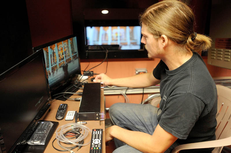 "Tyler Richardson, 27, technical director at the Waterville Opera House, manages the live satellite simulcast of The Metropolitan Opera's performance of Tchaikovsky's ""Eugene Onegin,"" from the control room at the Waterville Opera House today. The performance was the first of 10 operas from the Metropolitan Opera to be shown via satellite at the Waterville Opera House. The next is Shostakovich's ""The Nose"" on Wednesday, Oct. 30 at 7 pm."