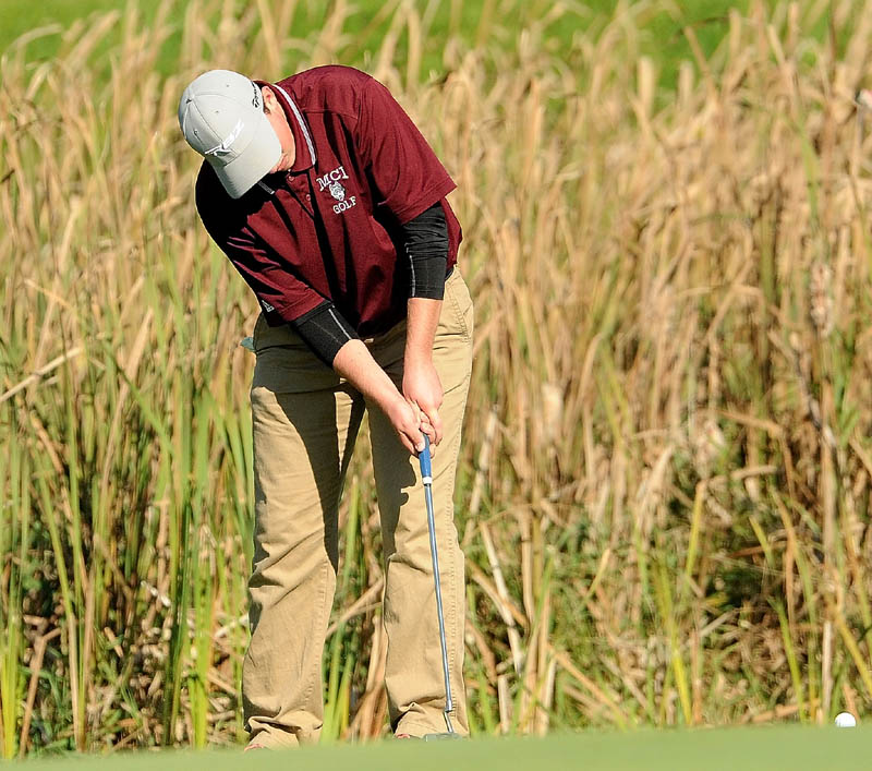 Maine Central Institute's Gavin Dugas putts on the 18th hole during the individual golf championships at Natanis Golf Course in Vassalboro on Saturday.