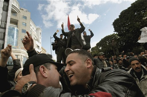 Police officers celebrate the ouster of their president as they demonstrate in Tunis on Jan. 22, 2011. Almost a quarter-century ago, a young American political scientist achieved global academic celebrity by proclaiming that the collapse of communism had ended the discussion on how to run societies, leaving