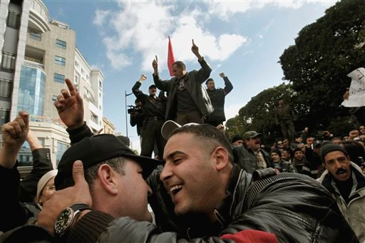 "Police officers celebrate the ouster of their president as they demonstrate in Tunis on Jan. 22, 2011. Almost a quarter-century ago, a young American political scientist achieved global academic celebrity by proclaiming that the collapse of communism had ended the discussion on how to run societies, leaving ""Western liberal democracy as the final form of human government."" In Egypt and around the Middle East, after a summer of violence and upheaval, the discussion, however, is still going strong. And almost three years into the Arab Spring revolts, profound uncertainties remain."