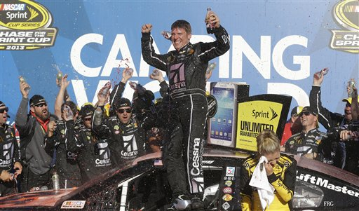 Sprint Cup Series driver Jamie McMurray celebrates after winning the NASCAR Sprint Cup Series auto race at the Talladega Superspeedway in Talladega, Ala. on Sunday. Talladega Superspeedway;Sprint Cup
