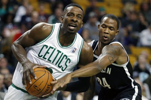 Boston Celtics' Jeff Green, left, drives for the basket past Brooklyn Nets' Chris Johnson (24) in the first quarter of a preseason NBA basketball game in Boston, Wednesday, Oct. 23, 2013. (AP Photo/Michael Dwyer)