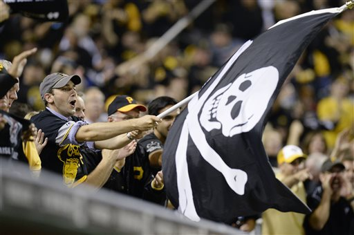 A Pittsburgh Pirates fan waves a Jolly Roger flag as the Pirates play the Cincinnati Reds in the NL wild-card playoff baseball game Tuesday, Oct. 1, 2013, in Pittsburgh. (AP Photo/Don Wright)