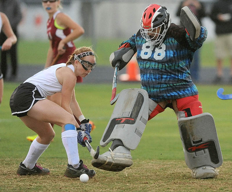 Skowhegan's Renee Wright, left, battles with Bangor High School goalie Rachel Luc, during a game at Tuesday in Skowhegan. The Indians defeated the Rams 10-0.