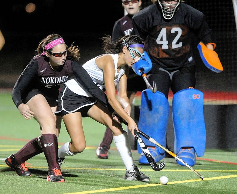 Skowhegan's Rylie Blanchet, right, tries to deflect a pass on goal as Nokomis' Kamryn Foss tries to defend in the first half Thursday of the Kennebec Valley Athletic Conference field hockey championship at Thomas College in Waterville.