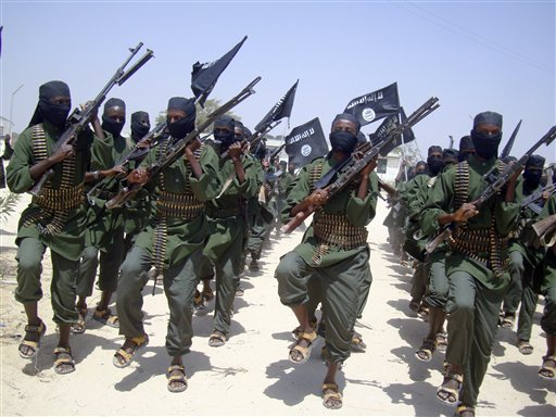Al-Shabab fighters march with their weapons during military exercises on the outskirts of Mogadishu, Somalia, on Feb. 17, 2011. Foreign military forces carried out a pre-dawn strike today against foreign fighters in the same southern Somalia village where U.S. Navy SEALs four years ago killed a most-wanted al-Qaida operative, officials said.
