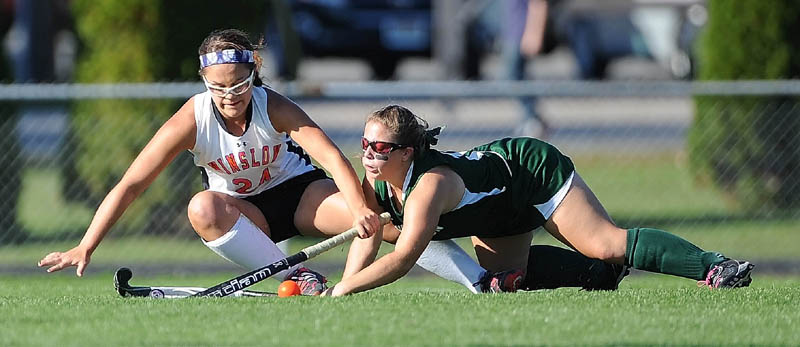 MAD SCRAMBLE: Winslow's Brooke Haskell, left, collides with Mt. View's Lindsey Moody in the first half Thursday in Winslow. Winslow defeated Mt. View 3-0.