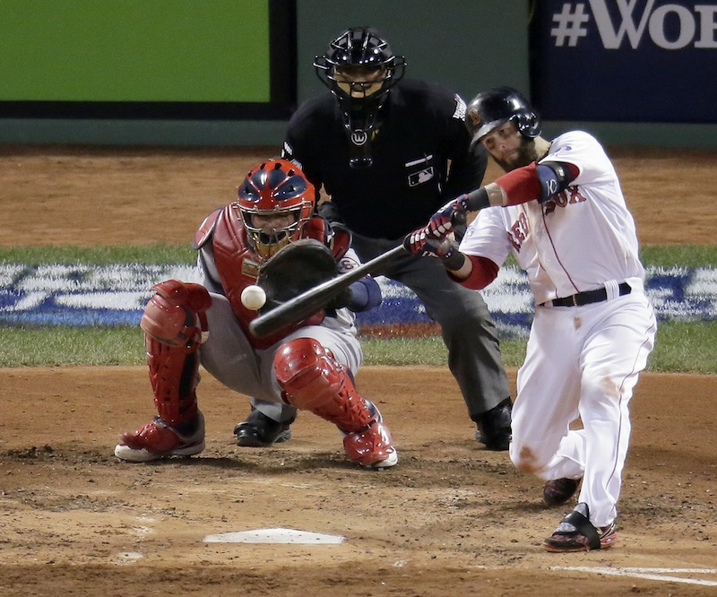 Boston Red Sox's Dustin Pedroia hits a double during the fourth inning of Game 2 of baseball's World Series against the St. Louis Cardinals Thursday, Oct. 24, 2013, in Boston. MLB