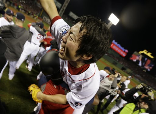 Boston Red Sox designated hitter David Ortiz carries relief pitcher Koji Uehara after winning Game 6 of baseball's World Series against the St. Louis Cardinals Wednesday, Oct. 30, 2013, in Boston. The Red Sox won 6-1 to win the series. (AP Photo/David J. Phillip) MLB