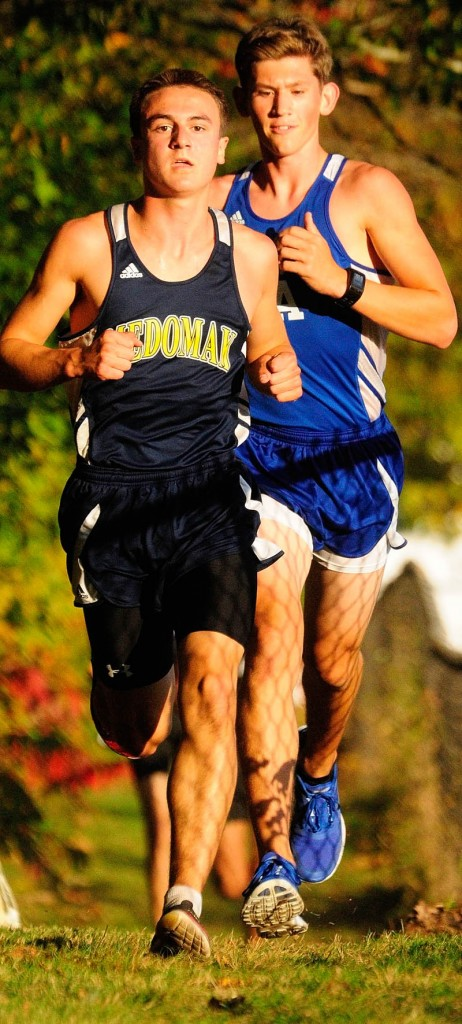 Medomak's Gavin Felch, left, passes Erskine Academy's Gavin Felch during a cross country meet on Wednesday at Erskine Academy in China. They stayed in that order to finish first and second.