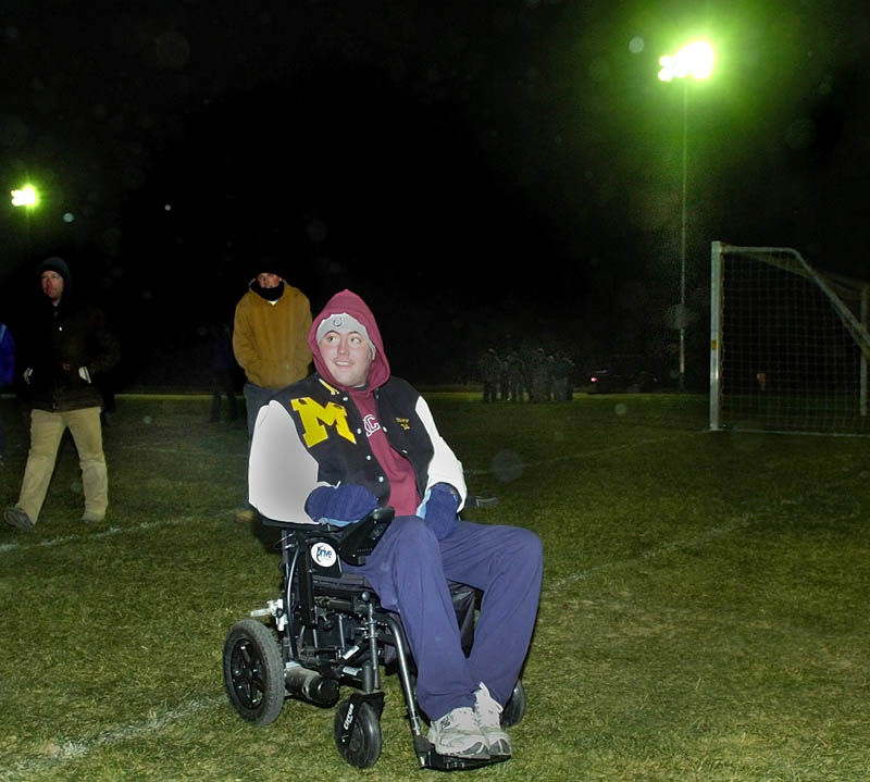 Ricky Gibson rolls across the football field after flipping the switch to turn on the newly installed lights in this Nov. 2008 photo. READFIELD MARANACOOK RICKY GIBSON