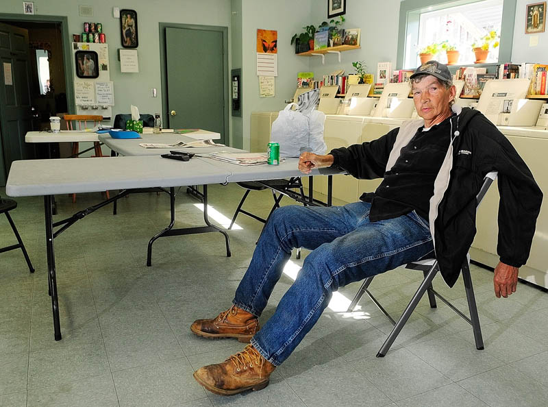 Roland Rideout sits in Mary's Place Laundry on Thursday in Augusta. The laundromat near the corner of Washington and Jefferson Streets is close to the apartment building where he lived that was closed by the city for safety code violations.