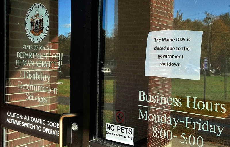 This sign in the window announces that Department of Health and Human Services Disability Determination Services office is closed due to federal government shutdown on Tuesday October 8, 2013 in Winthrop.