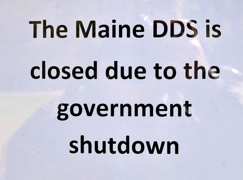 This sign in the window announces that Department of Health and Human Services Disability Determination Services office is closed due to federal government shutdown.
