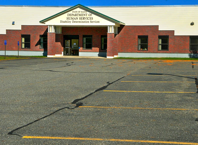 The parking lot in front of the closed Department of Health and Human Services Disability Determination Services office was empty on Tuesday in Winthrop.