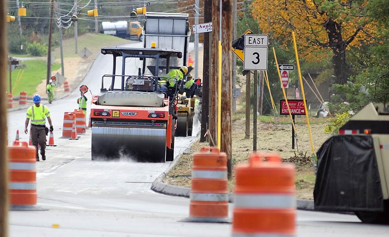 Paving work continues on Route 3, Old Belgrade Road, between Route 27 and Bog Road on Thursday in Augusta.