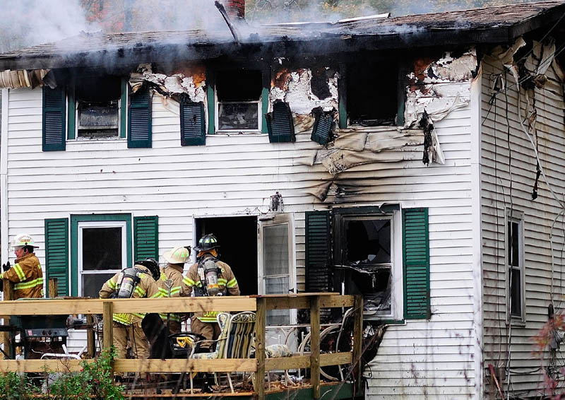 Firefighters work at 119 Granite Hill Road today in Manchester. An early morning fire there claimed Sam Spinicci, 56, owner of Kennebec Taxi and a Navy veteran, his family said.