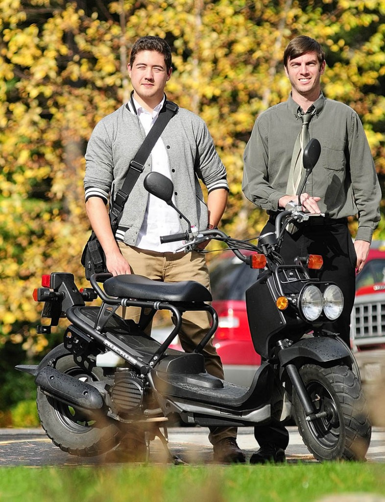 Myles Chung and Dan Emery on Thursday with a Honda Ruckus in Augusta. The pair plan to ride on scooters across the county next year.