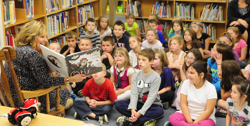 """First Lady Ann LePage reads """"Otis,"""" by Loren Long, to schoolchildren Thursday at Gilbert Elementary School in Augusta, as part of Jumpstart's Read for the Record initiative. Together with Jumpstart and the Pearson Foundation, Mrs. LePage will join children and adults across the country in attempting to set a new world record for the largest shared reading experience. The event is part of a nationwide, early education awareness campaign that each fall focuses national attention on the importance of reading."""
