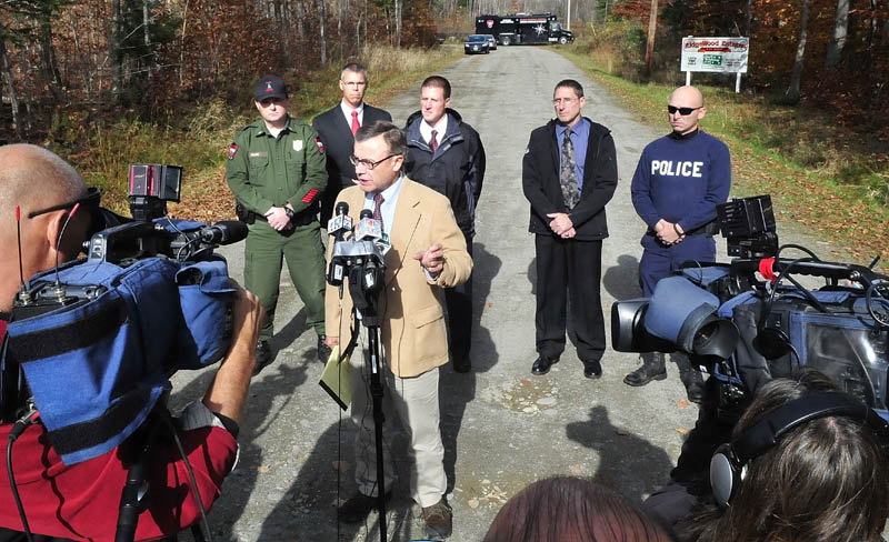 Steve McCausland, spokesman for the Maine Department of Public Safety, is surrounded by law enforcement officers and media during a press conference on Nike Lane in Oakland on Wednesday, following a search for missing toddler Ayla Reynolds.
