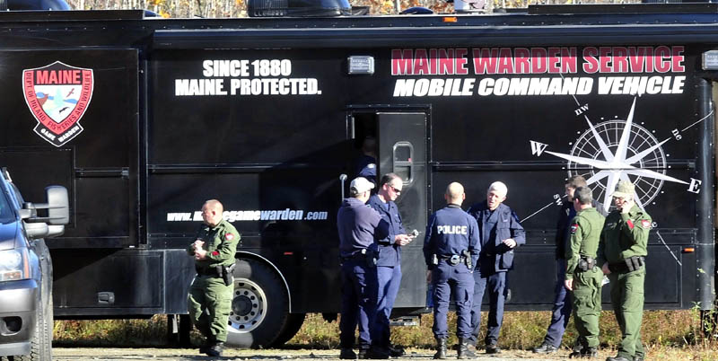 Officers from various agencies confer outside the Maine Warden Service Mobile Command Vehicle parked on Nike Lane in Oakland as officers searched the woods for signs of missing toddler Ayla Reynolds on Wednesday.