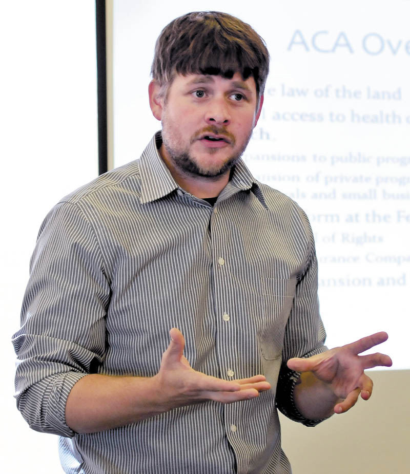 Jake Grindle, of the Western Maine Community Action Program, explains the Affordable Care Act to a group at the Waterville Public Library today.