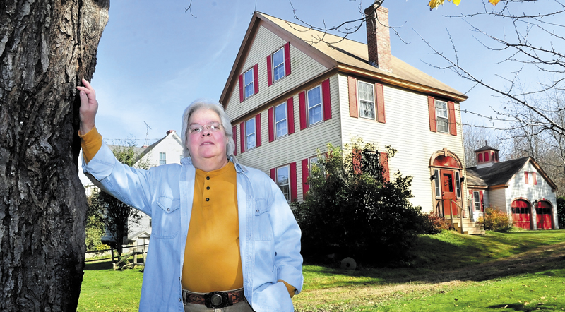 SPIRITS: Marty Golias stands outside her home on the Falls Road in Benton. Golias, originally from Salem, Mass., has lived at the home for 13-years and believes the home has friendly spirits inside.