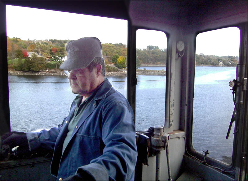 Belfast & Moosehead Lake Railroad train engineer Peter Reny throttles an engine along the Passagassawakeag River in Belfast during a recent scenic ride.