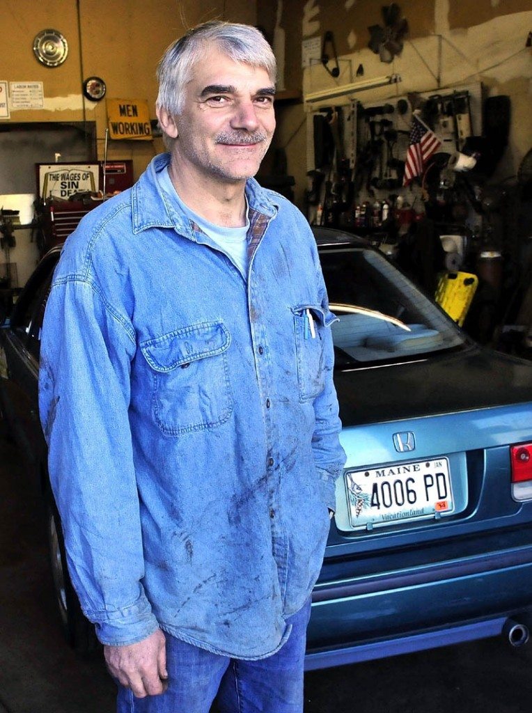 Peter Winslow is pictured in his garage in New Sharon. Winslow said he worked on John Pelletier's vehicle and may have been his only area friend before he died in an accident earlier this year.